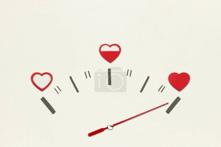 Love meter. Creative valentines concept photo of speedometer with hearts on grey background.