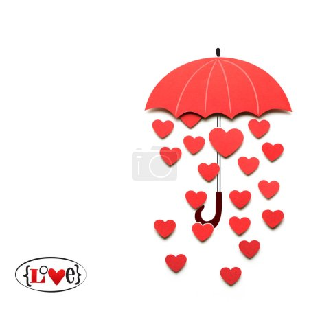 Raining love. Creative valentines concept photo of paper umbrella with hearts raining down on white background.