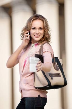 beautiful businesswoman posing outdoors