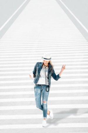 woman walking on zebra cross