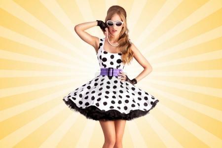 pin-up girl in a retro polka-dot dress
