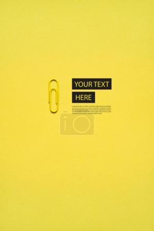 Paper clip on yellow
