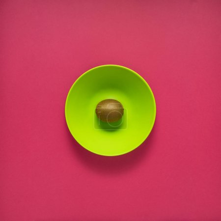 Photo for Creative concept photo of kitchenware, painted plate with food on it on pink background. - Royalty Free Image