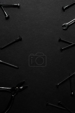 Photo for Creative concept photo of painted tools and nails on black background. - Royalty Free Image