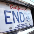 License plate Route 66 on Dodge Charger 1973 car a...