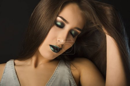 Portrait of beautiful brunette woman with high fashion bright ma