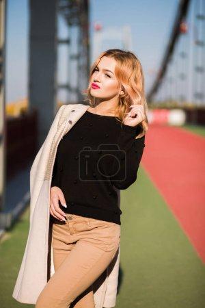 Street portrait of glamor blonde model wears stylish outfit, pos