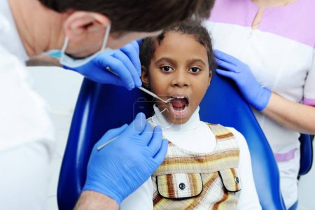 little African girl with dark skin in dentistry