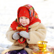 Little girl in a fur coat and red scarf Russian dr...