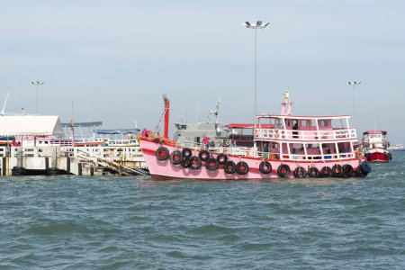 Pink ship at the pier.