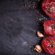 Raw fresh marbled filet mignon steaks with seasoni...