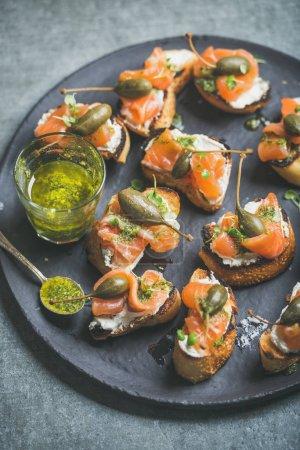 salmon crostinis with pesto sauce