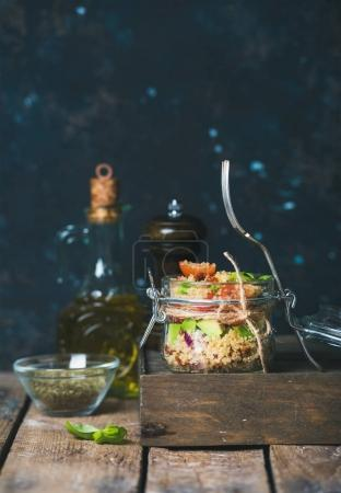 Photo for Homemade jar quinoa salad with sun-dried tomatoes, avocado and fresh basil leaves. Detox, dieting, vegetarian, vegan, clean eating food concept - Royalty Free Image