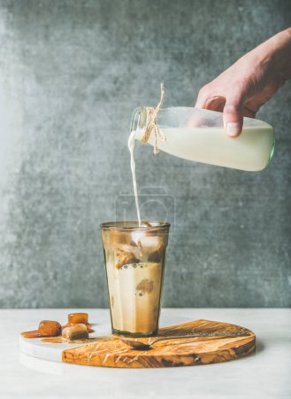 pouring milk to Iced latte