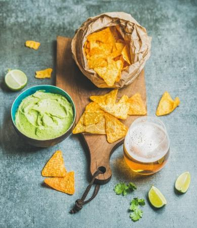 Mexican corn chips and guacamole sauce