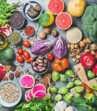 Photo for Clean eating concept over grey concrete background, top view. Vegetables, fruit, seeds, cereals, beans, spices, superfoods, herbs for vegan, gluten free, allergy-friendly weight loosing or raw diet - Royalty Free Image