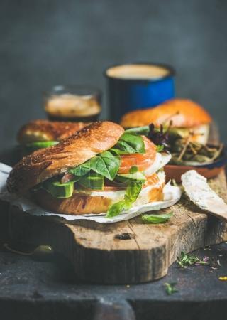 Bagel with salmon on cutting board