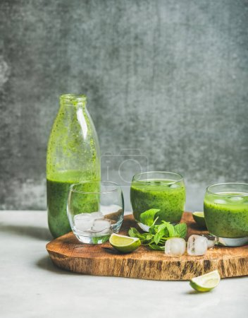 green smoothie in glasses and bottle