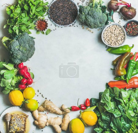 Photo for Clean eating healthy cooking ingredients. Vegetables, beans, grains, greens, fruit, spices over grey marble background - Royalty Free Image