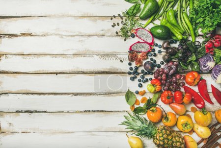Photo for Helathy raw vegan food cooking background. Fresh fruit, vegetables, greens, superfoods over white wooden table - Royalty Free Image