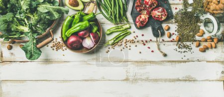 Winter vegetarian, vegan food cooking ingredients over white wooden background