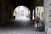 Old european street with paving stones and a bicycle