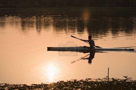 Chiang rai, Thailand, March 2018: the man training kayak sails in the river sunset at chiang rai, Thailand