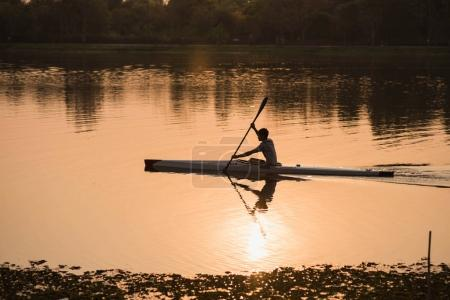 Chiang rai, Thailand, March 2018: Rower kayaking sails the river sunset