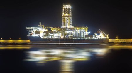 oil rig in the harbor at night