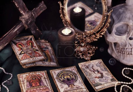 Tarot cards, mirror and burning candle.