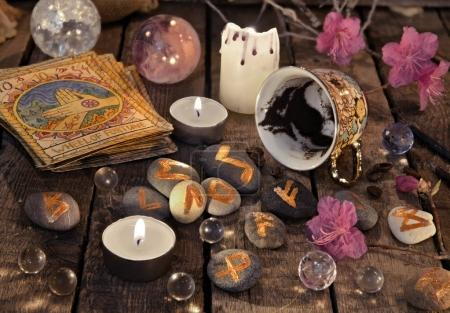 Mystic still life with cup of coffee and stone runes