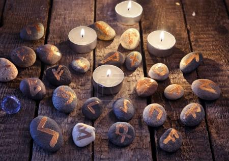 Mystic still life with stone runes and candles