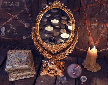 Magic mirror with Tarot cards and mystic objects