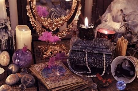 Divination rite with the tarot cards, flowers and mystic objects