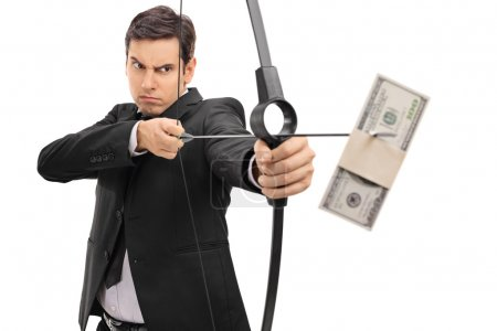 Businessman aiming with bow and arrow with money