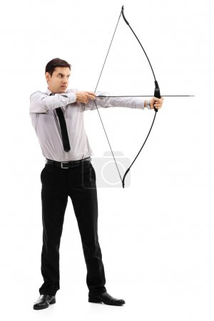 Young businessman aiming with a bow and arrow