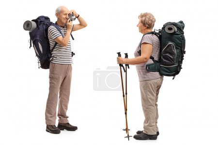 Male hiker taking a picture of a female hiker
