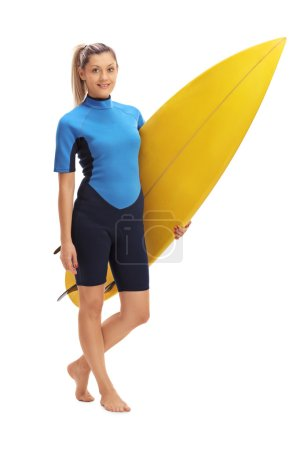 Female surfer posing with surfboard