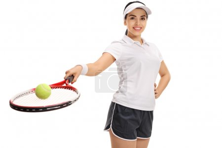 Female tennis player holding racket with ball