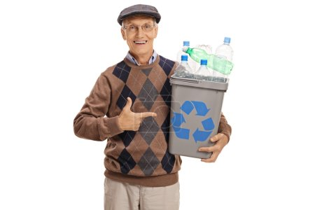 Elderly man holding a recycling bin and pointing