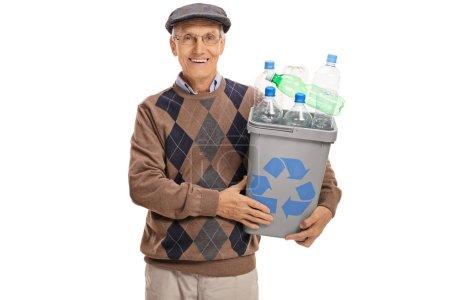 Happy mature man holding recycling bin full of plastic bottles