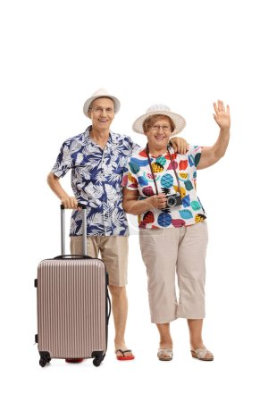 male tourist with suitcase and female tourist waving