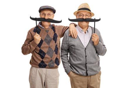 Seniors posing with big fake moustaches