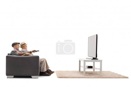 mature men sitting on a sofa and watching television