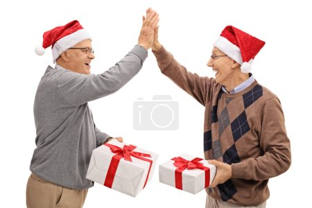 seniors exchanging christmas gifts and high fiving each other