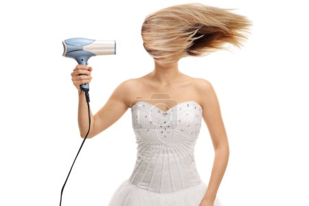 Bride blowing her hair with a hair dryer