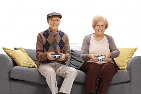 seniors on a sofa playing video games