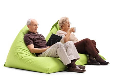 Elderly man and woman sitting on beanbags
