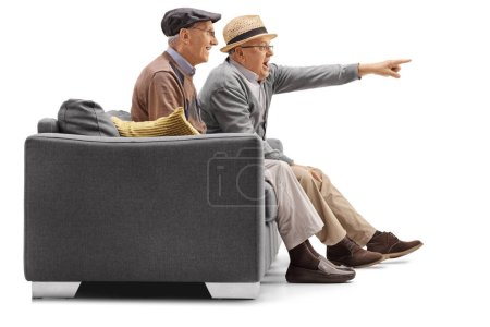 mature men sitting on a couch with one of them pointing