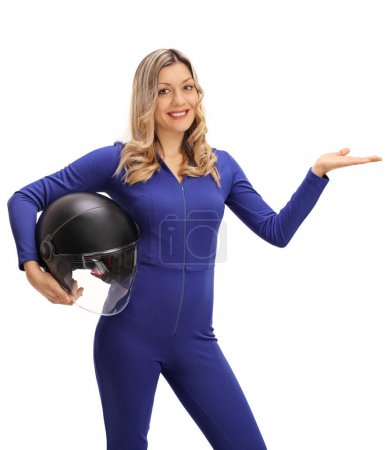 Female car racer holding helmet and gesturing with her hand